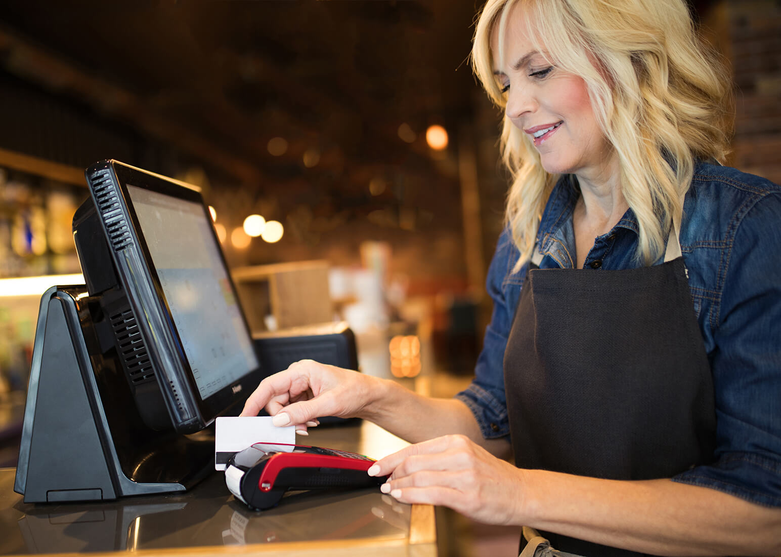 Woman processing a bankcard