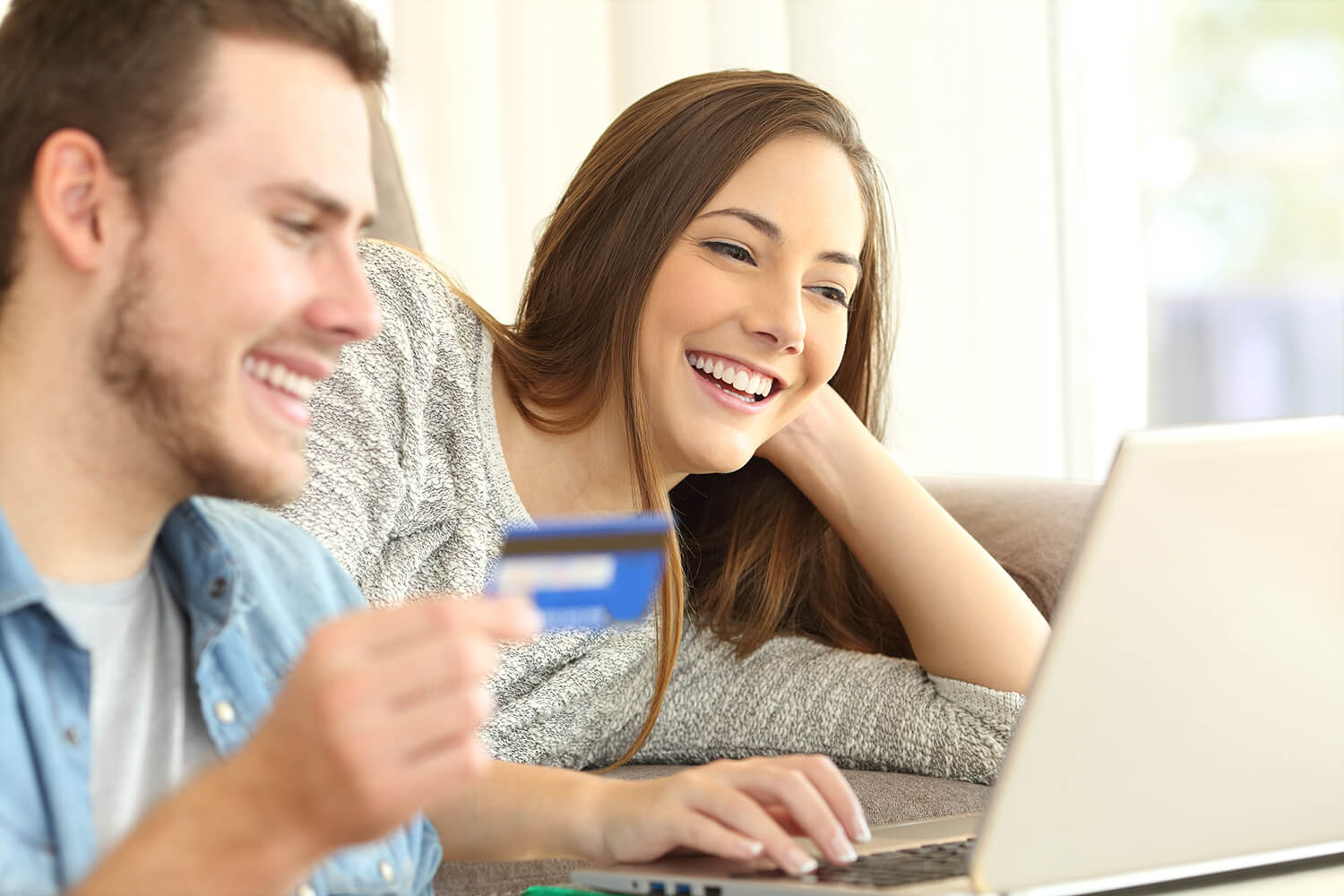 Young couple making purchase online